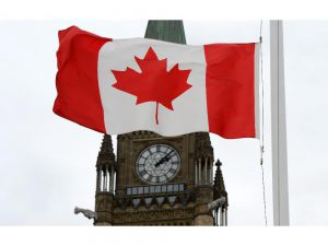 a-canadian-flag-blows-in-front-of-the-peace-tower_thumb-1.jpg